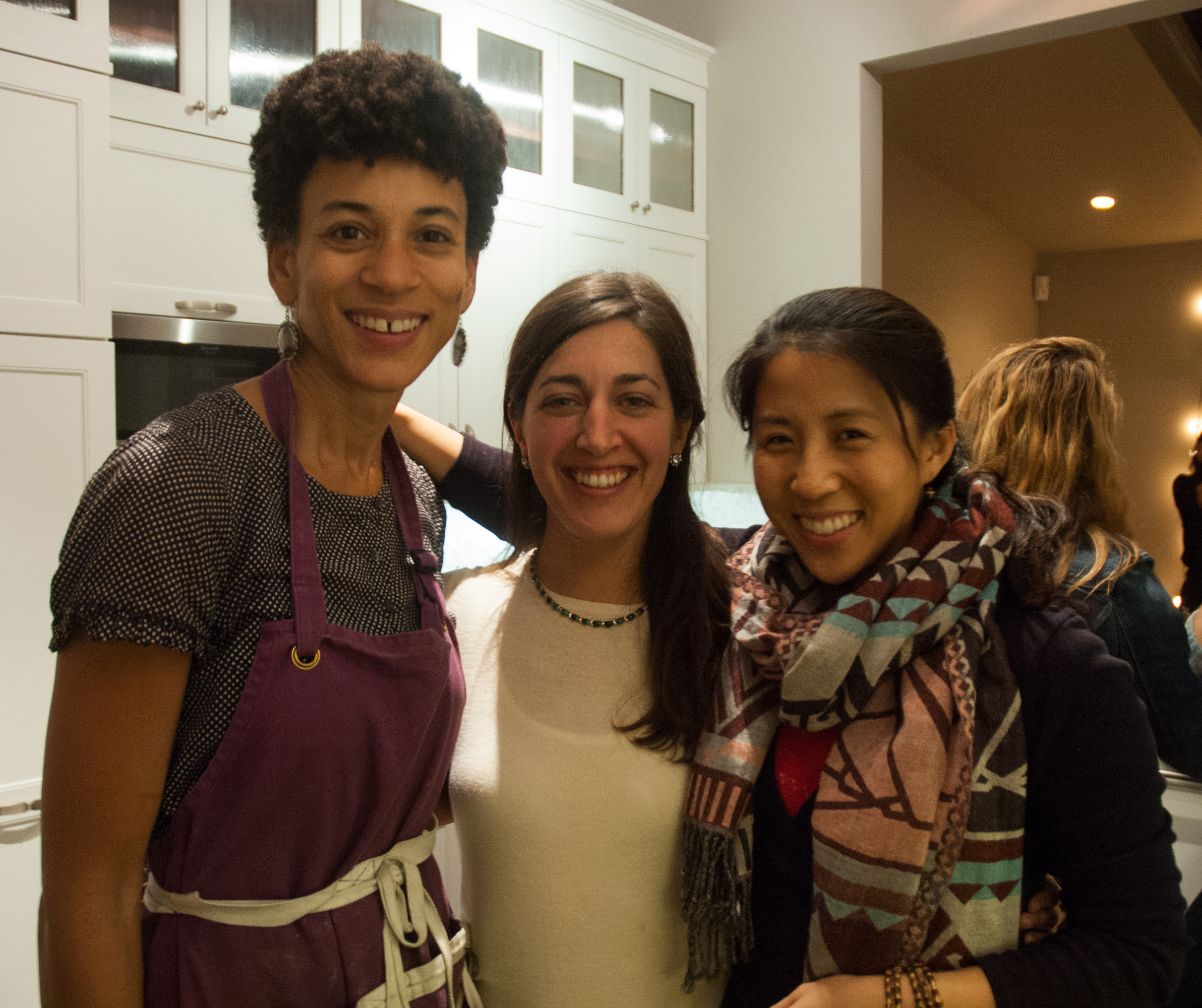 Jocelyn Jackson (left) of Grace Hearth, who prepared the food for the event, with Paige Phinney and Pei-Ru Ko.