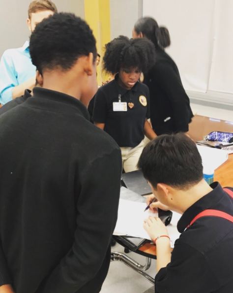 Our beatboxer, Hurlink, signing autographs for the students at Paul Habans Charter School in New Orleans!