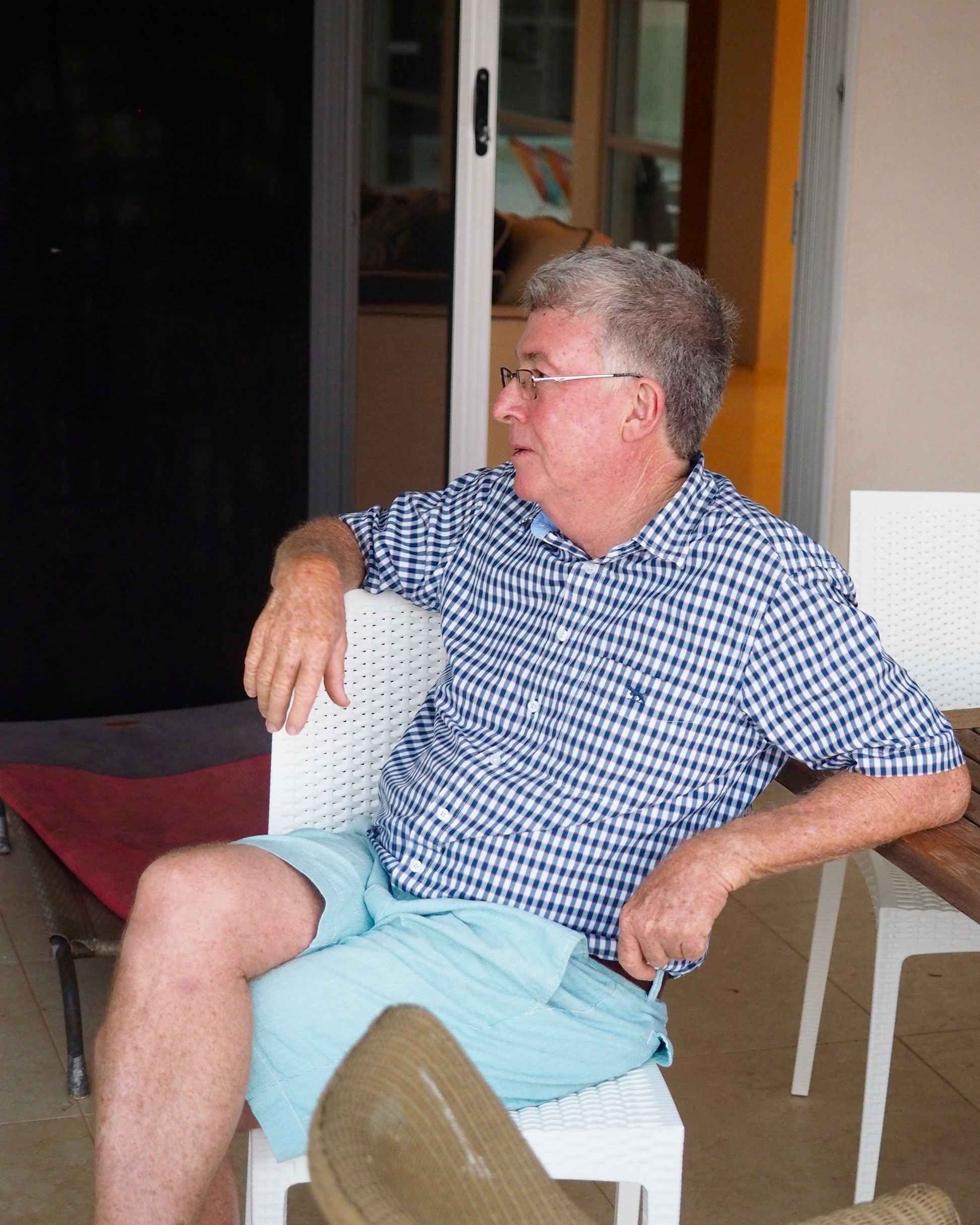 Ross Campbell sitting on his back porch at the Campbell house in Cleveland, Queensland, Australia.
