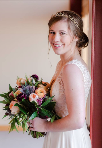 Brittany is wearing a custom Rebecca Schoneveld gown with a Melinda Rose headpiece