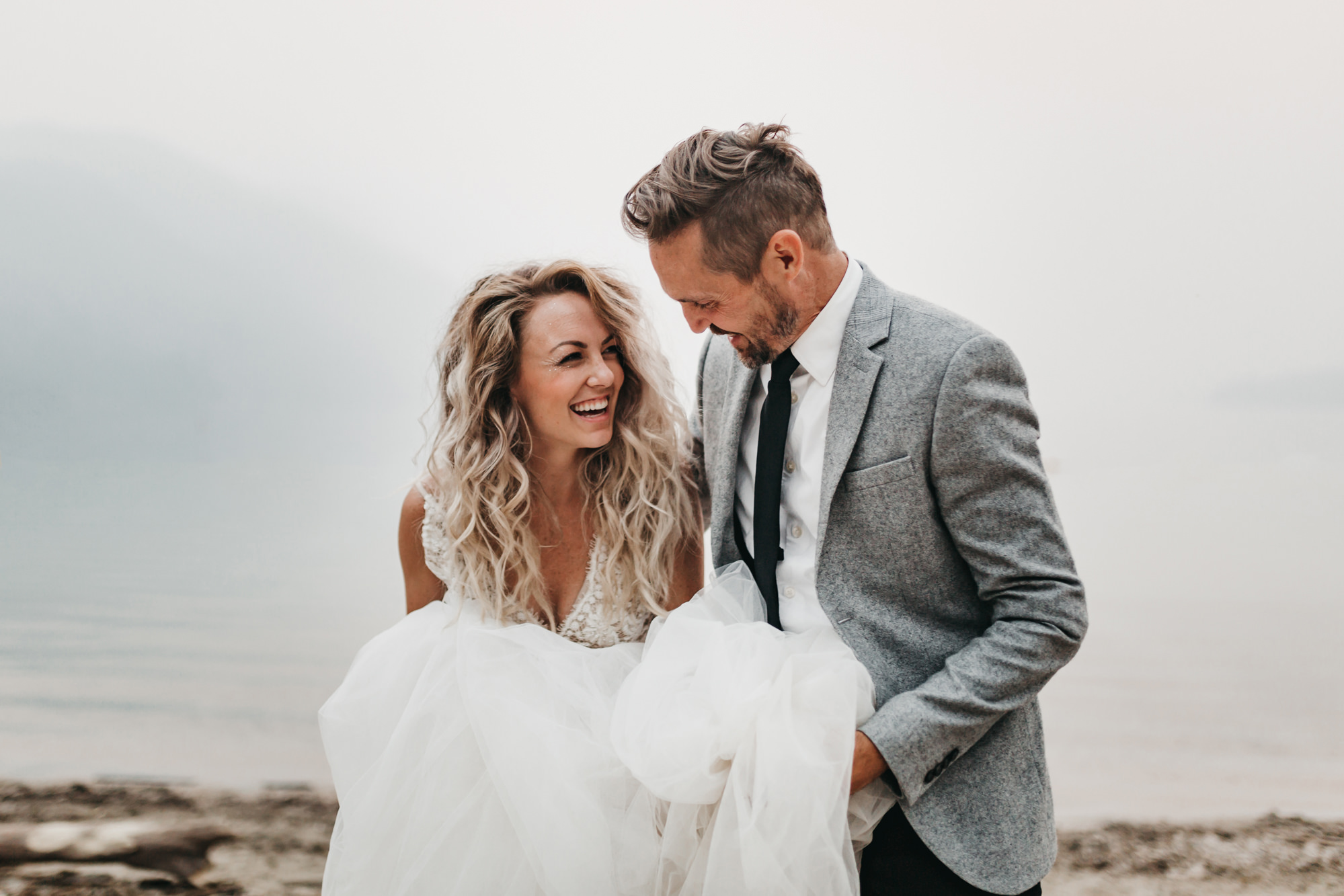 athena-and-camron-sara-truvelle-bridal-wenatchee-elopement-intimate-19-tulle-wedding-dress-smile.jpg