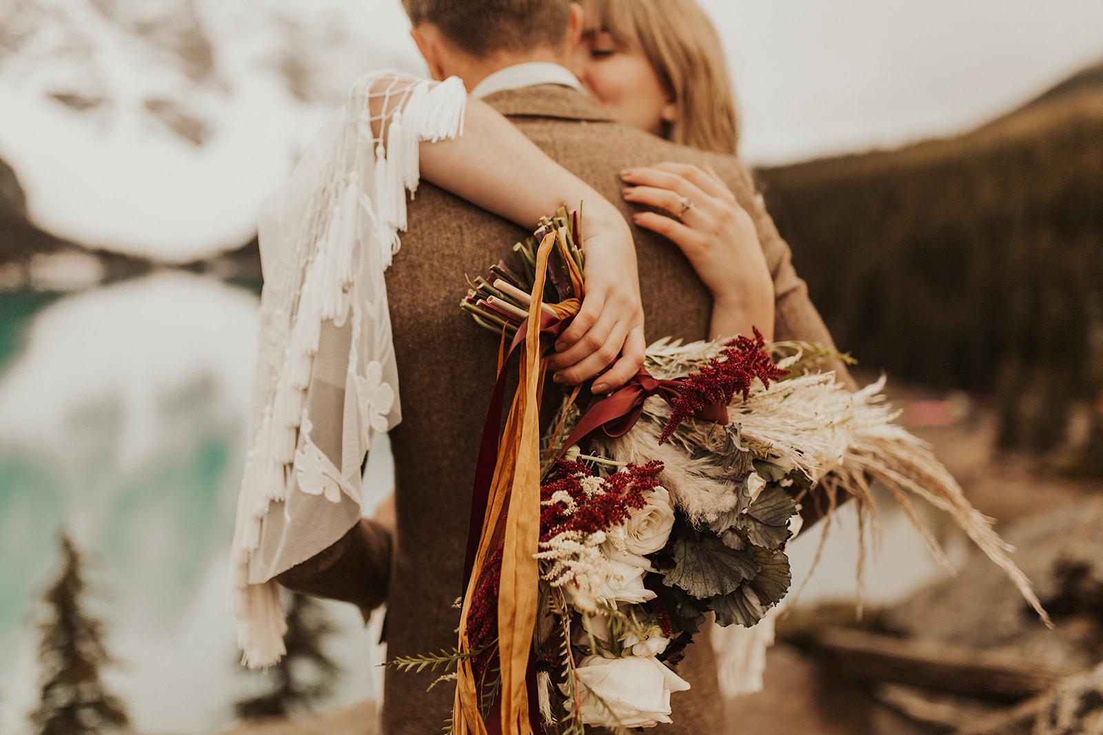 Banff Elopement l Lake Moraine Elopement l Vintage Bolo Tie l Pampas Grass Boho Boquet l Rue Design Wedding Dress l Banff Wedding Photographer l Destination Wedding Photographer l Katy Rose Photo_-48.jpg