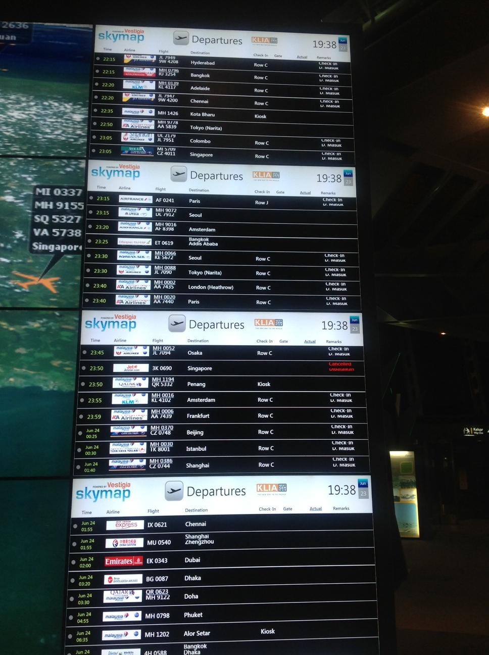 The flight departures board at KLIA shows MH370. Credit: My Savvy Traveller Digital Image Base