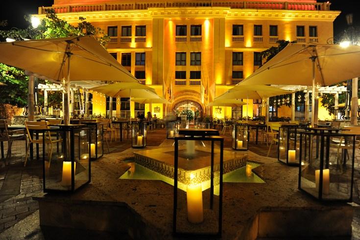 The front facade and open-air restaurant of the Charleston Hotel Santa Teresa