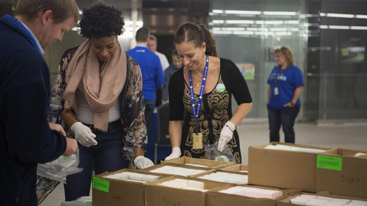 United Airlines employees gathered at the carrier's Willis Tower headquarters to pack hygiene kits. Credit: United