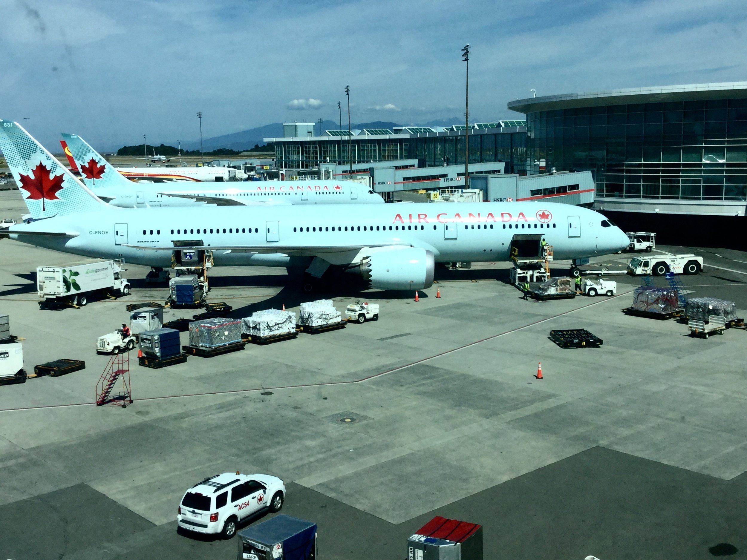 Our Air Canada 787-8 Dreamliner at YVR being readied for the long flight to FRA.
