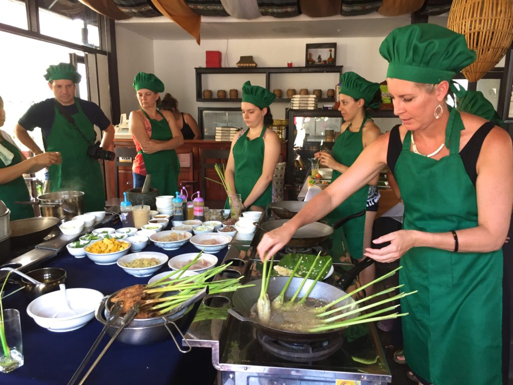 Hard at work learning to make Lao cuisine for lunch!
