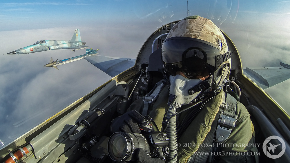 """3G Photographer Doug Glover prepares to capture images of an F-5N from VMFT-401, the """"Snipers""""."""