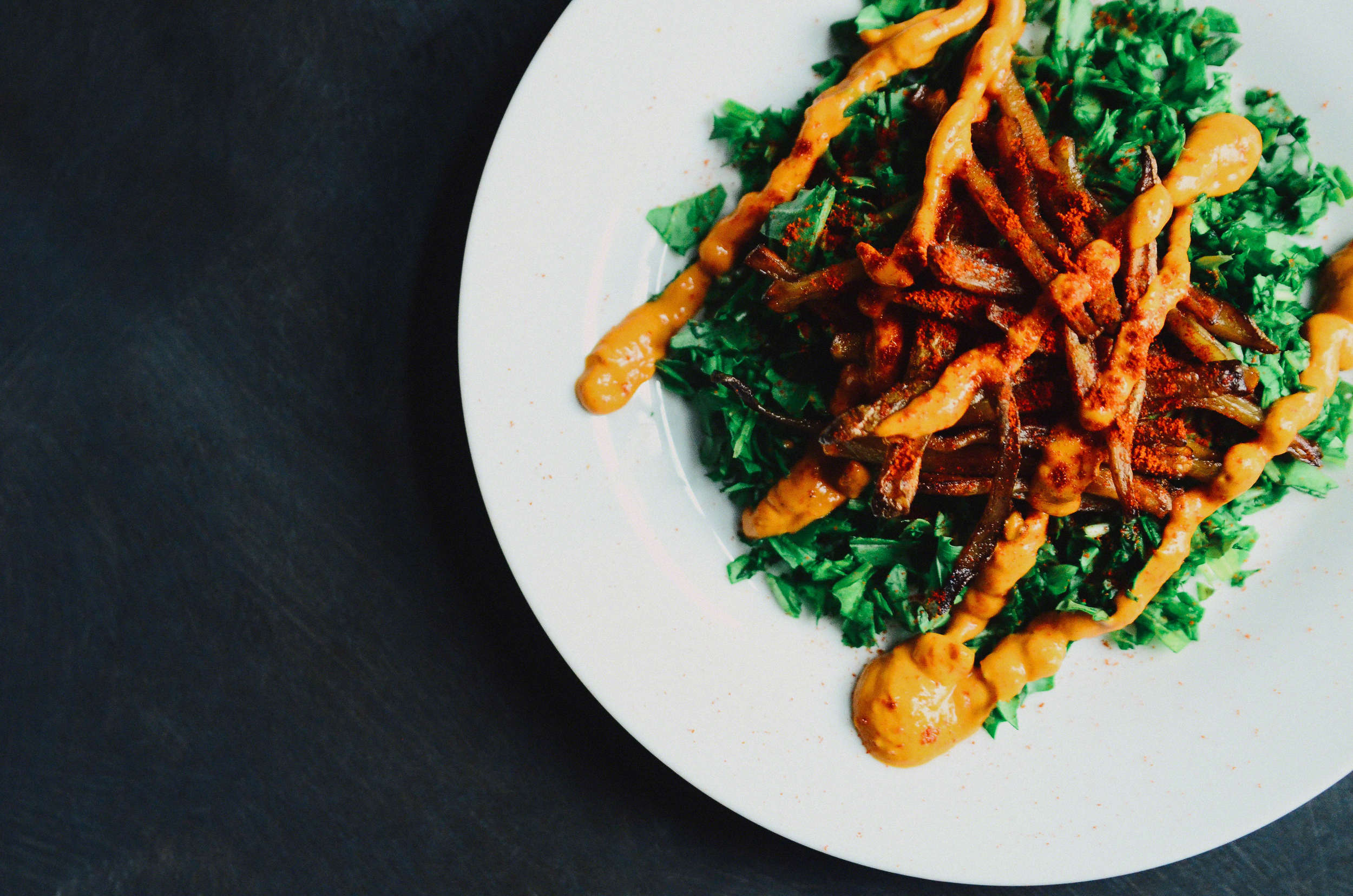 Smoky Baked Matchstick Fries with Chopped Arugula topped with Roasted Red Pepper Aioli(vegan) and Smoked Paprika   Seed Plant Water Grow