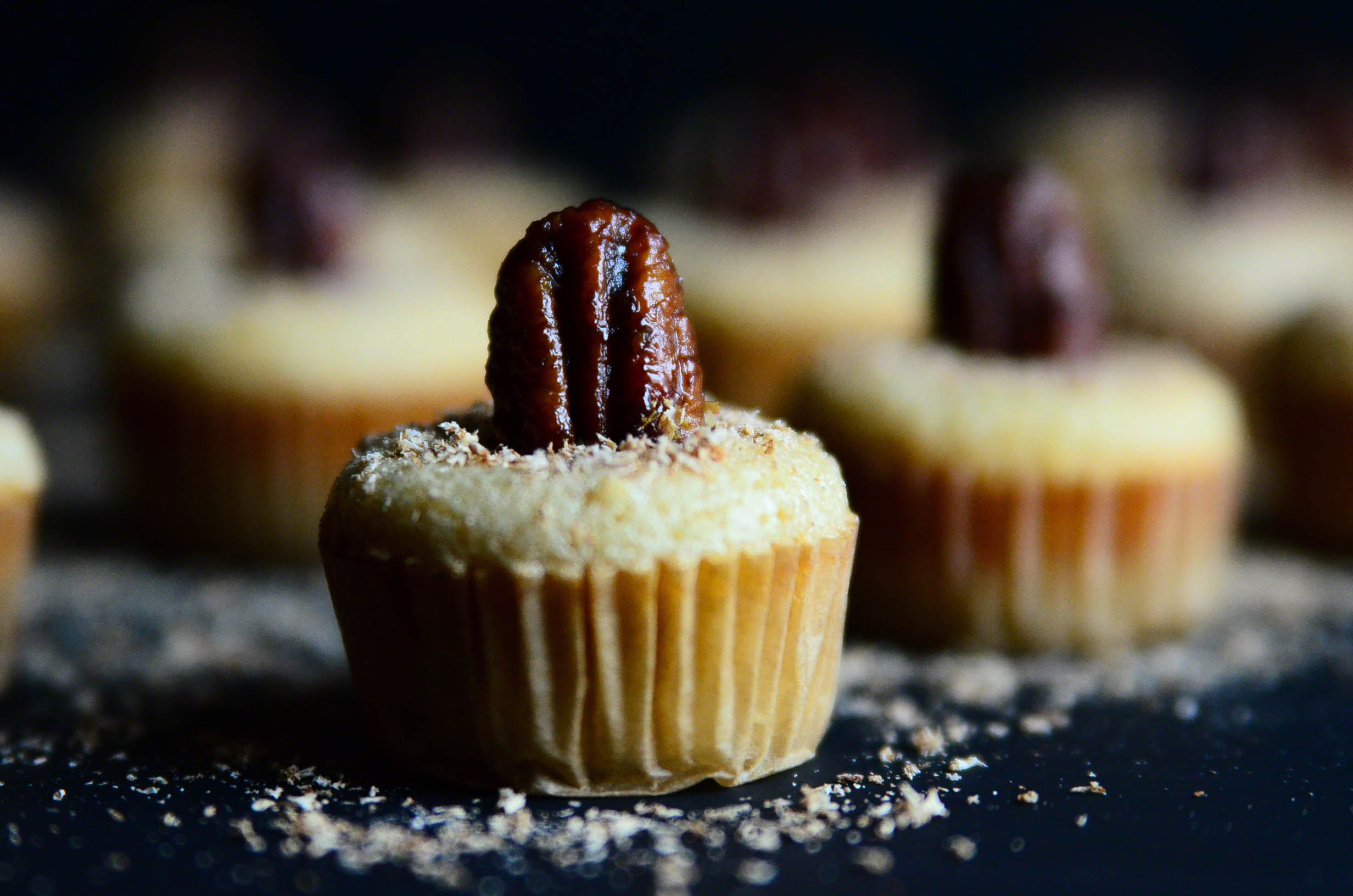 Honey Butter Bourbon Pecan Chess Mini Muffin Poppers topped with Nutmeg