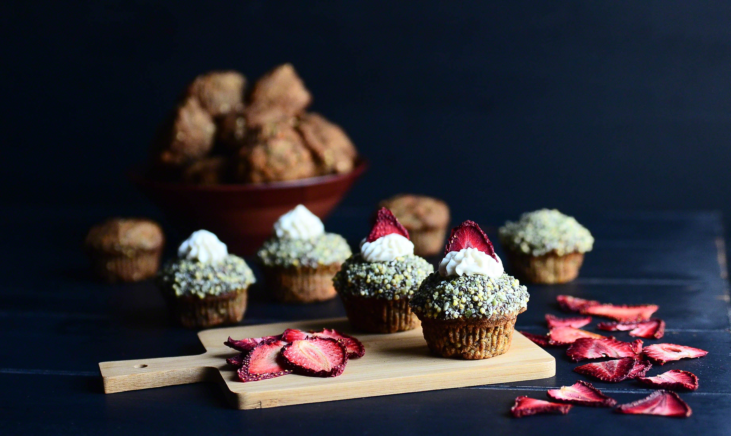 Three Seed Morning Muffins topped with Coconut Buttercream and Dehydrated Strawberries(Vegan + GF)