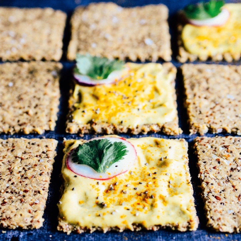 Lemon Seed Crackers topped with Banana Butter and Radish   Seed Plant Water Grow