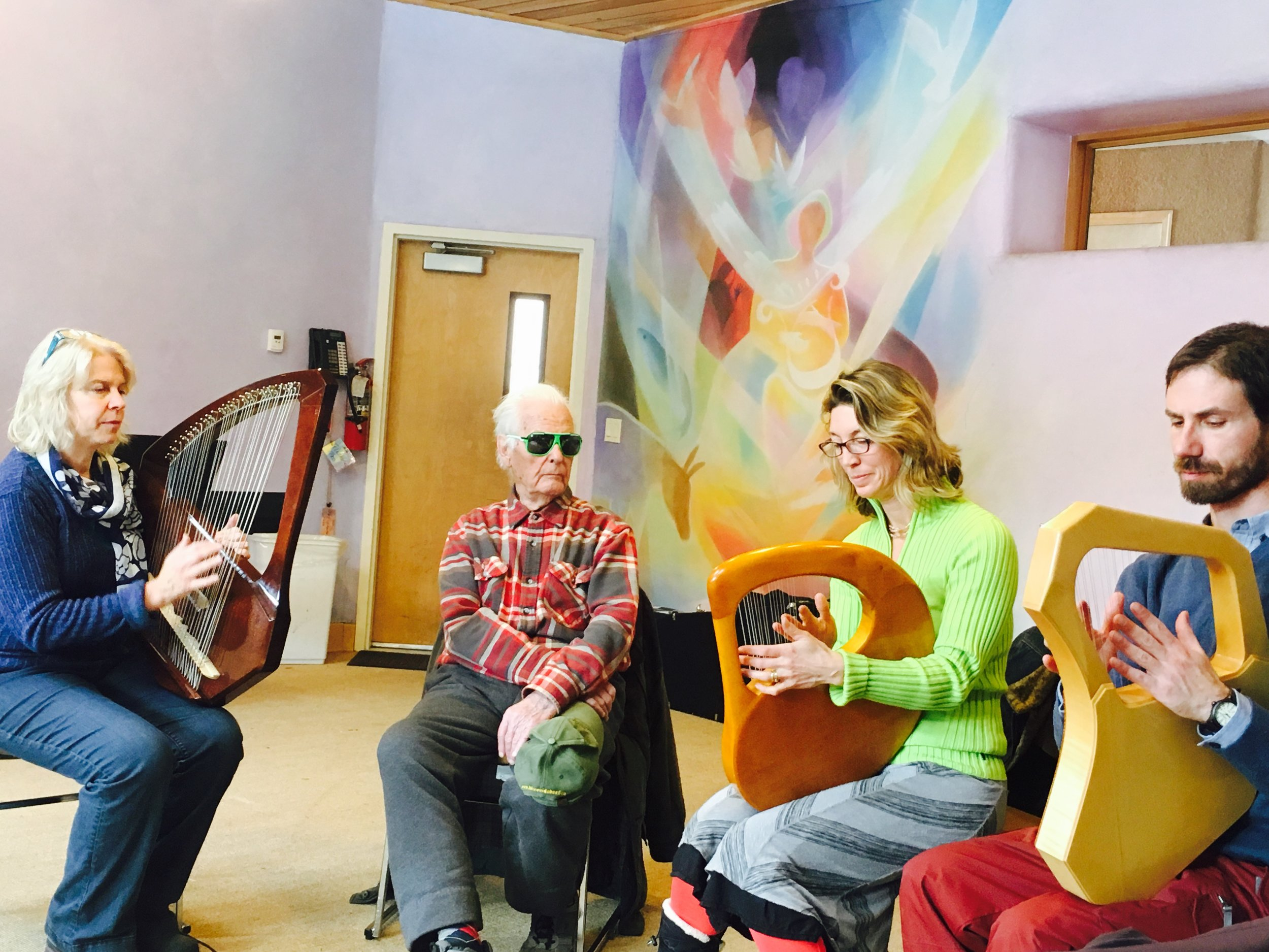 Pictured from left to right: Lorraine Curry, Hartmut Schiffer, Holly Richardson and Baruch Simon. Orpheus painted on the wall behind by local artist, Charles Andrade. Thank you to Itzel Salazar for taking the photo. (Itzel wants to learn to play!)