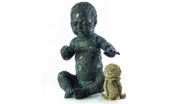 Vladimir Anslem,   boy Sculpture in coal with object in pyrite, 2013. Courtesy of the artist.