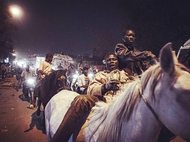 Ouaga Wild Wild West. Night ride. Burkina Faso. Décembre 2018. 2/3  #journalism #africa #portrait #photojournalism #color #snapseed #vscocam #vsco #reportage #documentary #journalisme #photojournalisme #story #vscoportrait #discoverportrait #horseracing #sheriff #cowboy #portraiture #horses #expofilm #humaneffect #agameofportraits #afrique #nikonphotography #burkinafaso