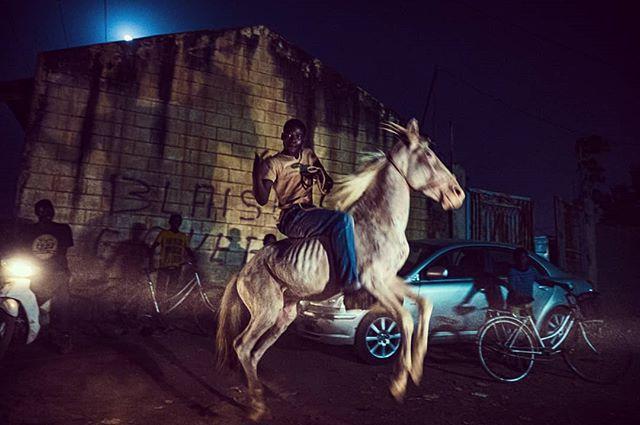 Ouaga Wild Wild West. Night ride. Burkina Faso. Décembre 2018. 1/3  #journalism #africa #portrait #photojournalism #color #snapseed #vscocam #vsco #reportage #documentary #journalisme #photojournalisme #story #vscoportrait #discoverportrait #horseracing #sheriff #cowboy #portraiture #horses #expofilm #humaneffect #agameofportraits #afrique #nikonphotography #burkinafaso