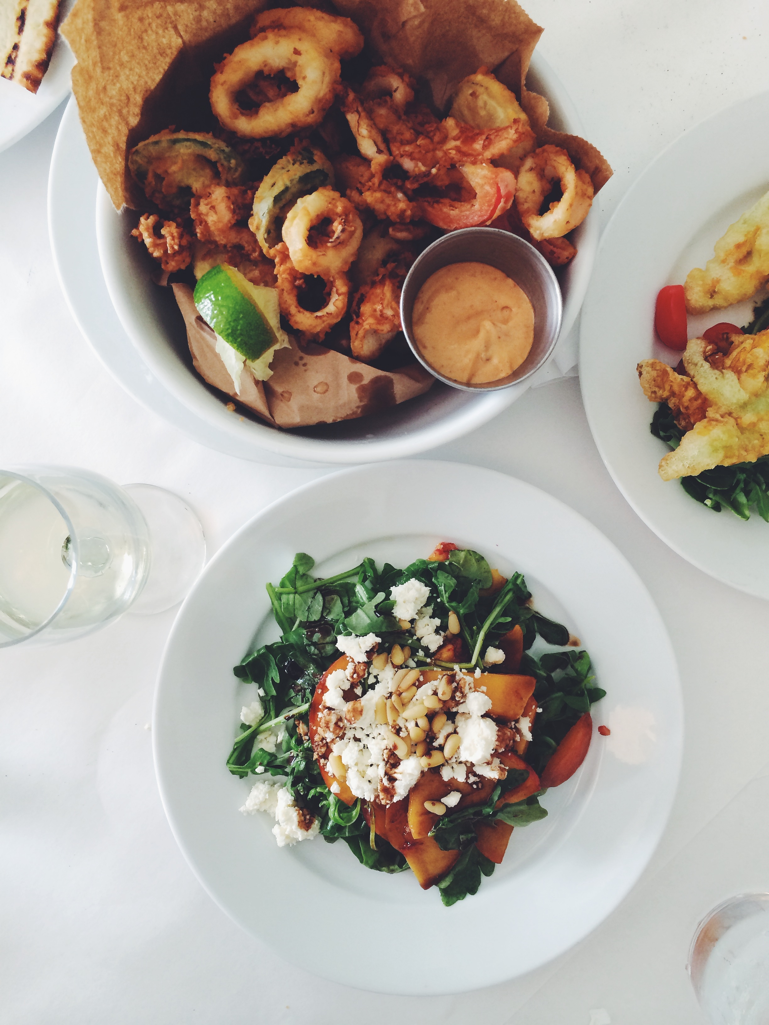 Grilled peach and arugula salad and local fritto misto at Noah's
