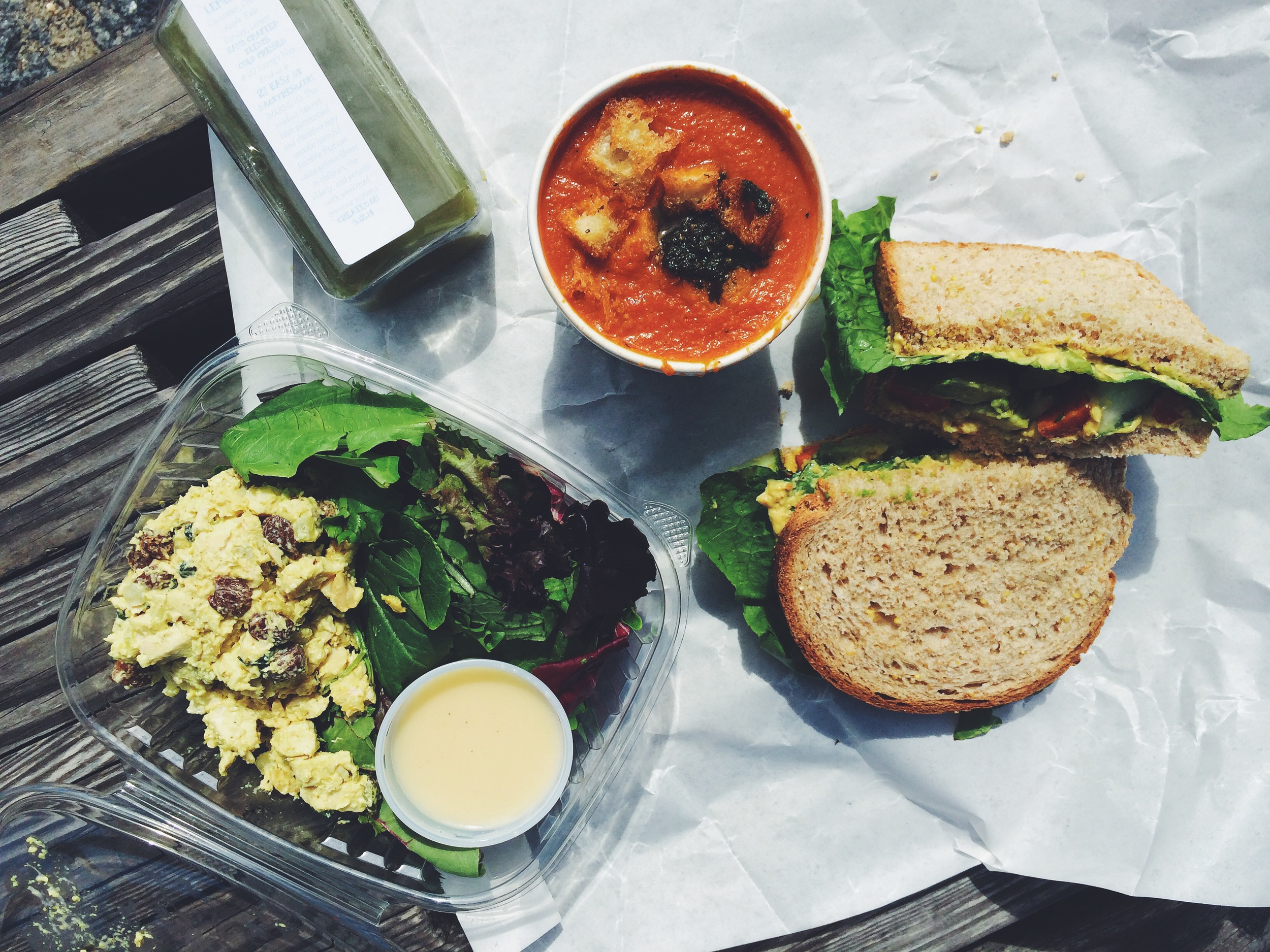 Provisions from Provisions: curry chicken salad, vegetarian sandwich, and vegan tomato soup with walnut pesto
