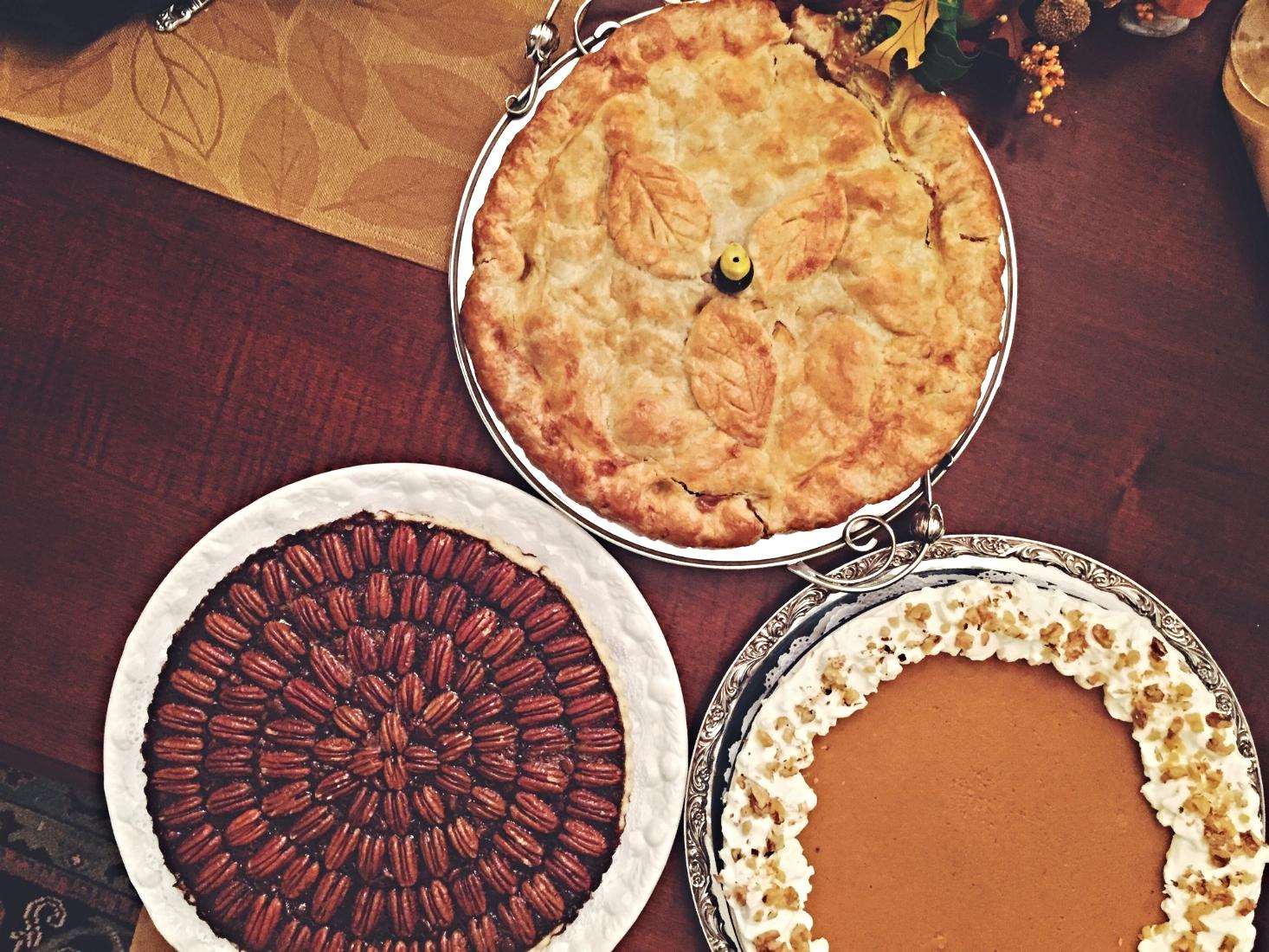 Burbon chocolate pecan, salted caramel apple, and sweet potato and pumpkin ginger pie