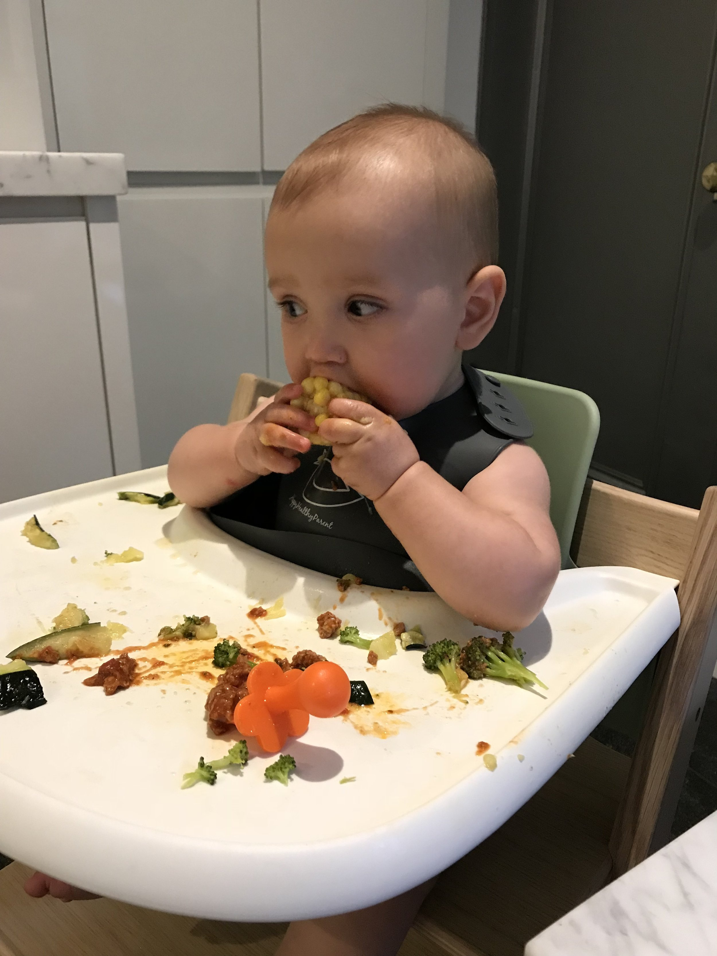 Jack enjoying some corn on the cob for the first time.