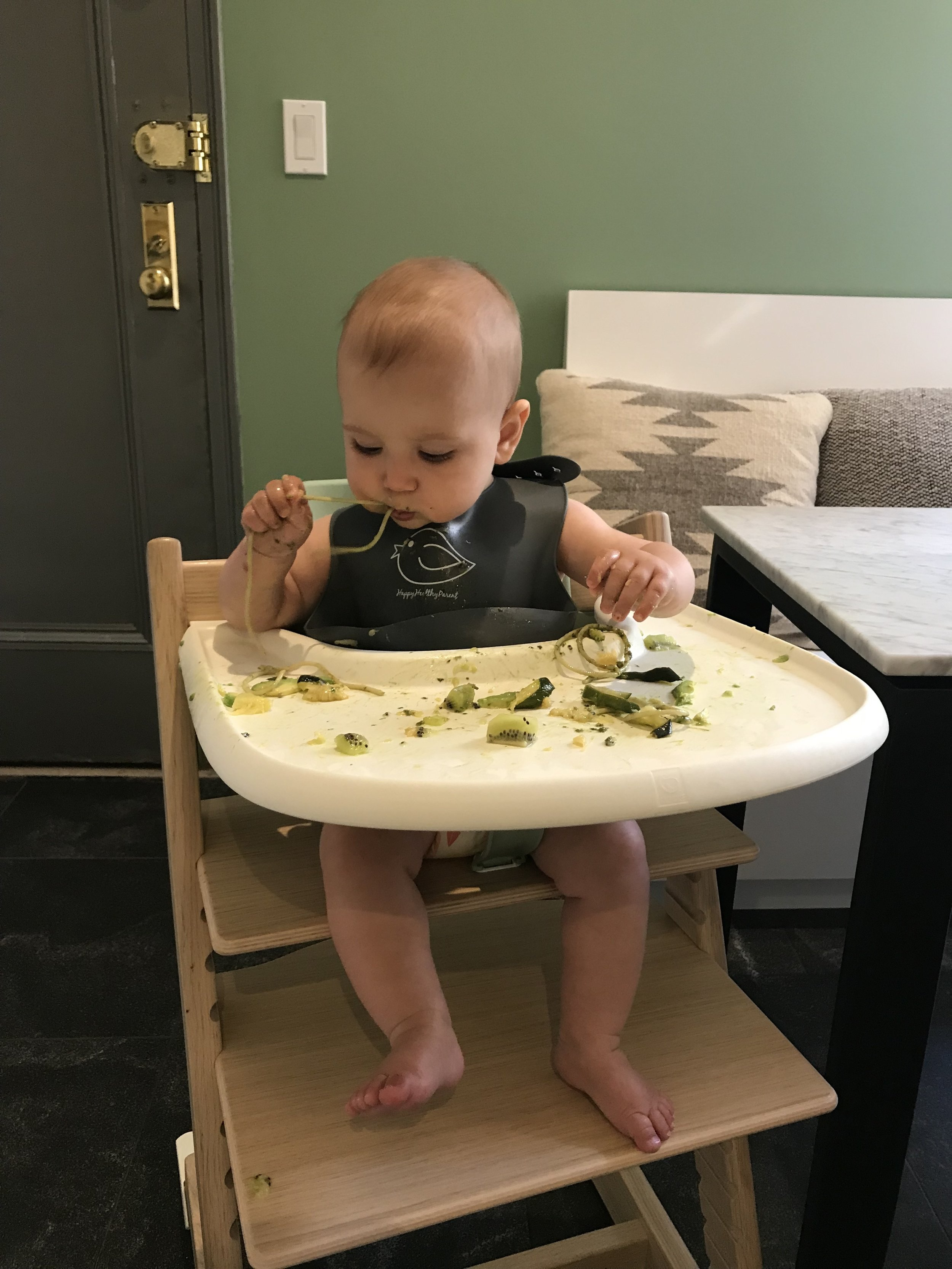 Jack enjoying spaghetti with kale pesto, kiwi, and roasted zucchini.