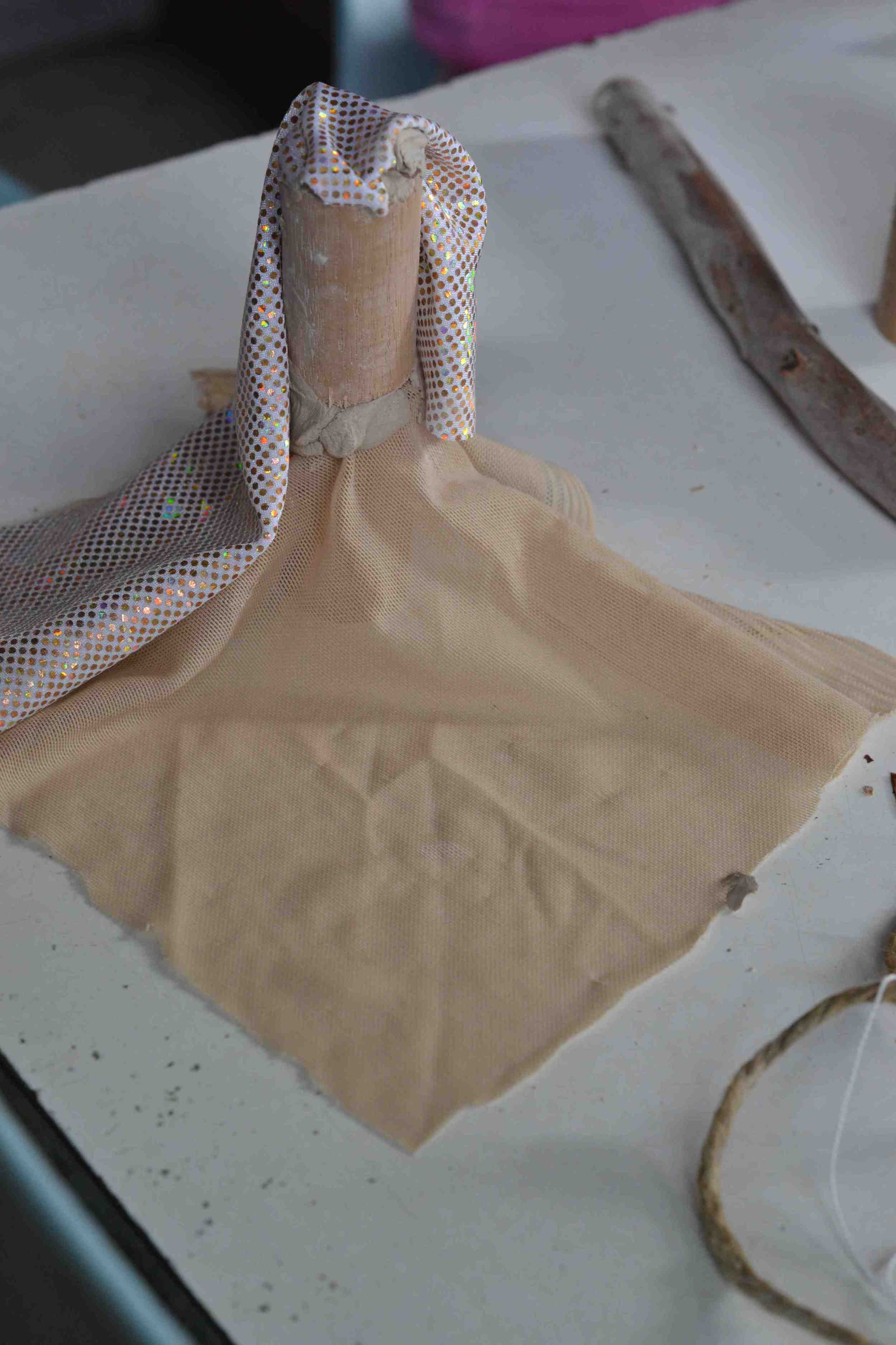 B: The glitter fabric returns