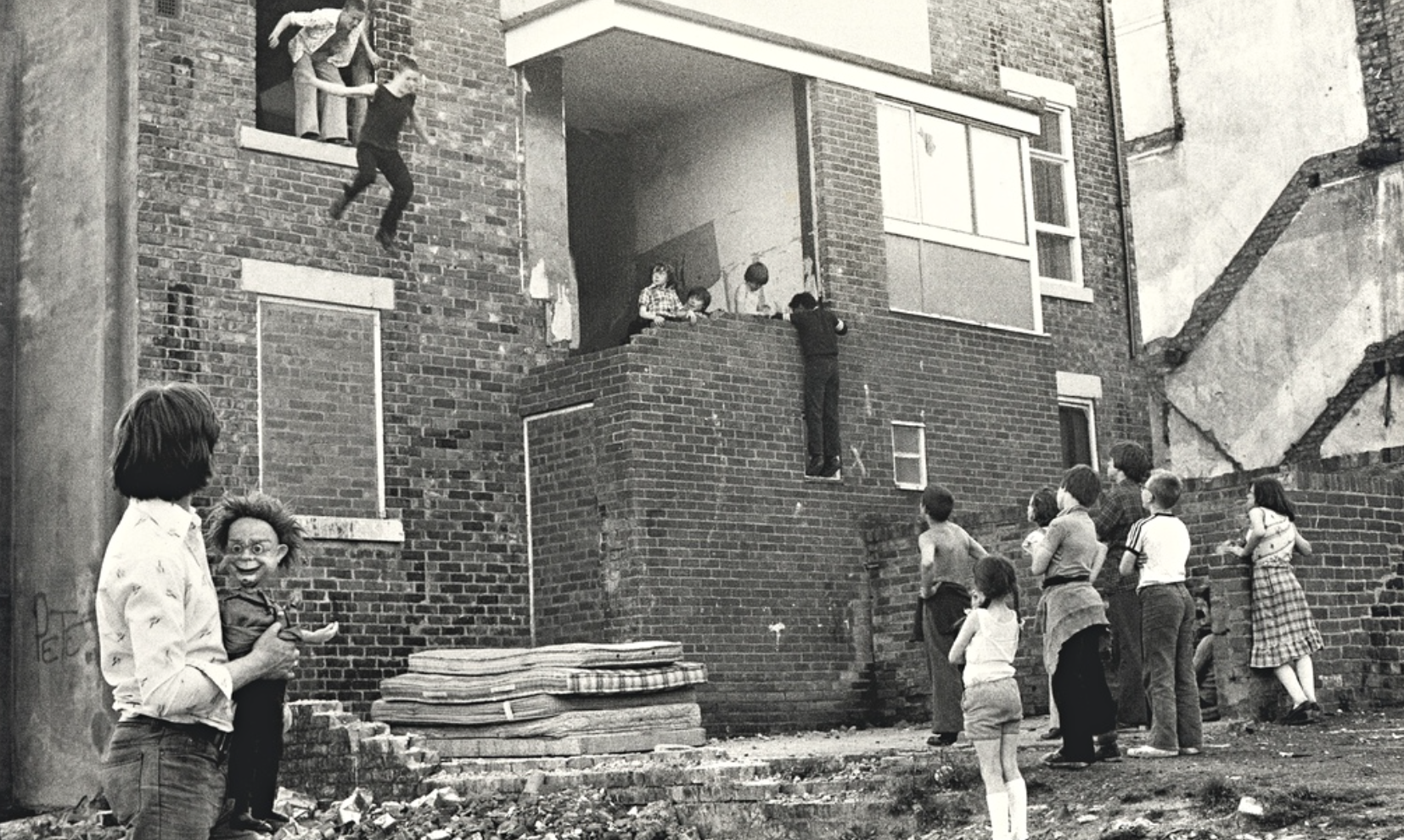 Glenn Murtha and his brother jump from a second-storey window. Photograph: Tish Murtha/AmberSide Collection