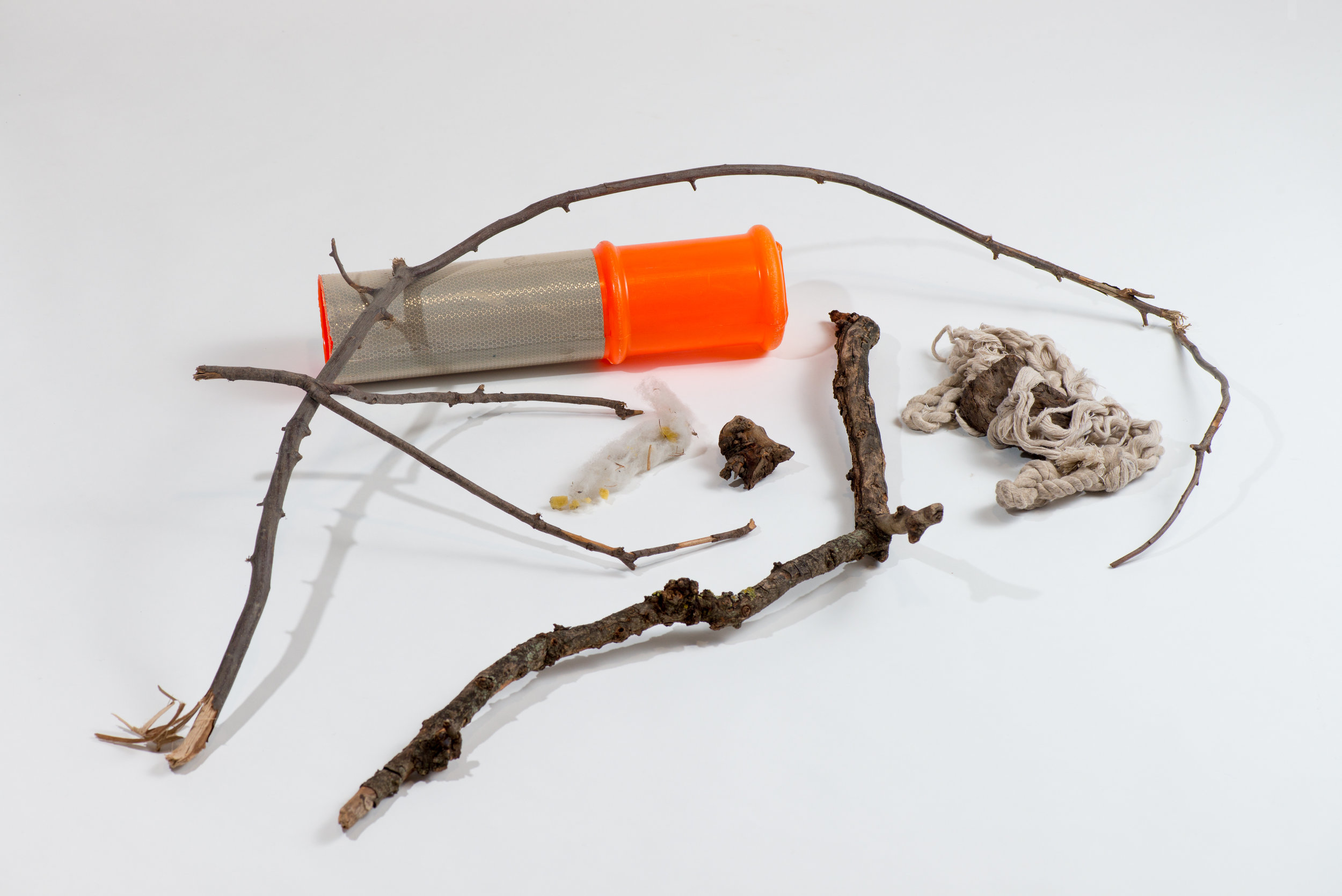 Kym Maxwell, Play Tools:Bow and Arrow,Pincher, Cannon Ball Launcher, Foam Gun, Grenade, Gun, and Rope and Weight,Collection of the Museum of Anticipation at Dandenong Primary School (Site DPS various locations internal school grounds). Materials: Sticks, branch, bollard top, root, foam with debris, rope and wood, 2018, inkjet print, 30cms x 40cms.