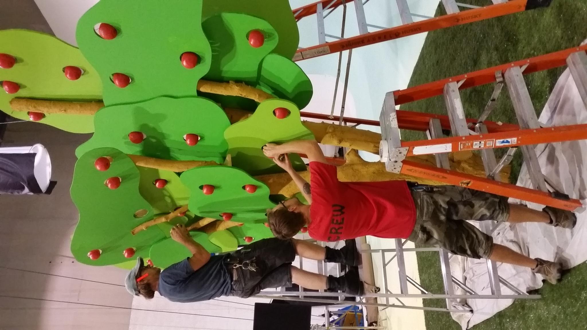 Union Set Dresser gary Surber(on ladder) works on a set piece for Health Partners with art assist tom kristjanson.