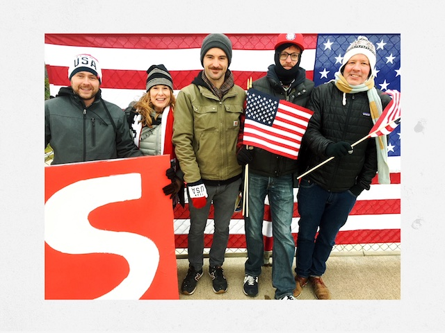 Art Dept with set dresser Bryan Bredahl, decorator Terri Gold, lead man Brian Simpson, dresser Tom Kristjanson and production designer Billy Bostock pose with flags on the I-94 overpass.