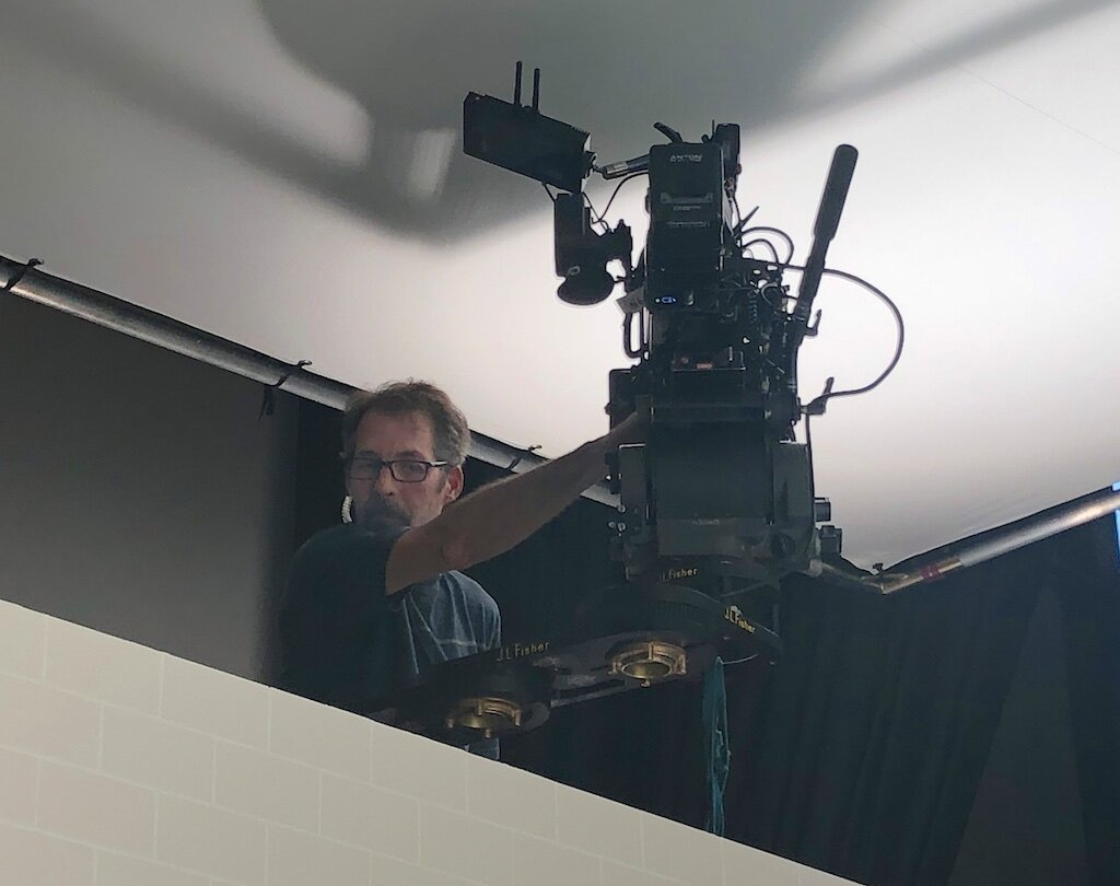 490 Key Grip David Pope adjusts the camera for the Target Baby shoot.