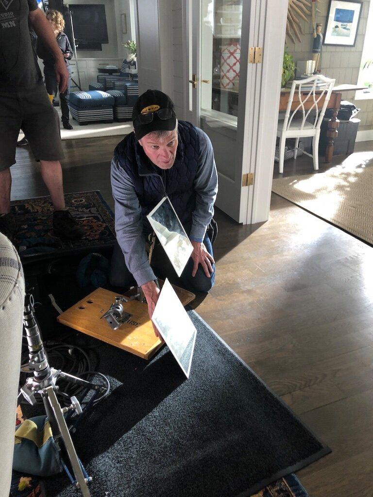 490 Gaffer Tom Franchett shines a reflector for the Marvin WIndows shoot.