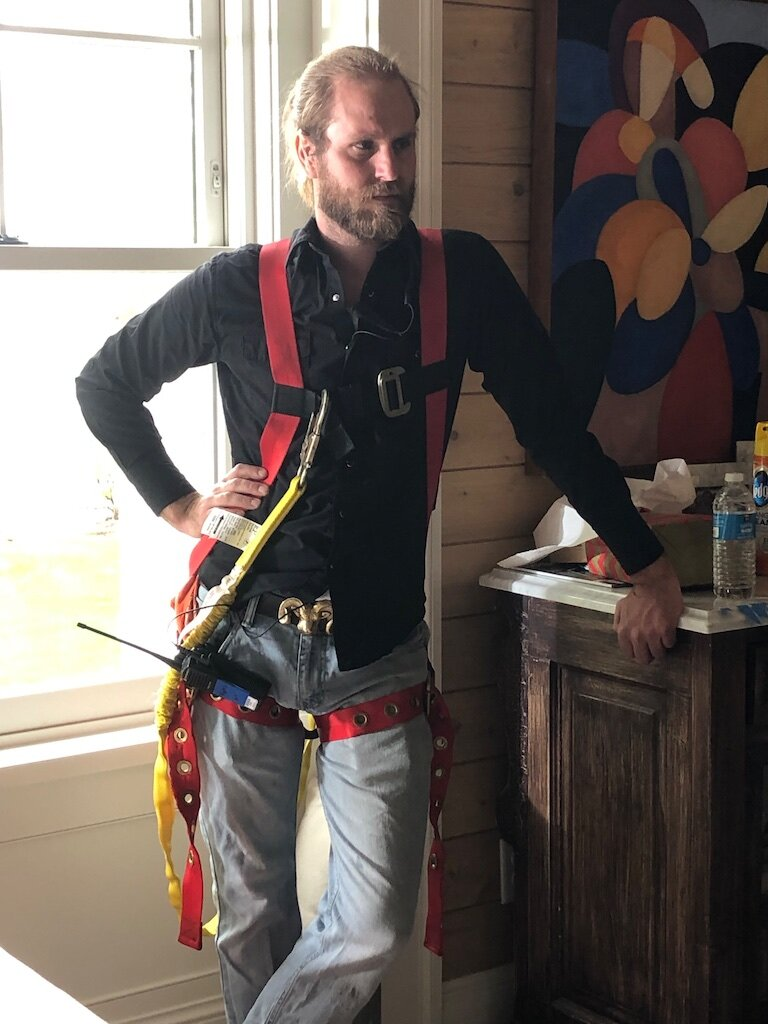 490 Set Dresser Matt Joyer wears his safety harness to adjust a window during a take for the Marvin WIndows shoot.