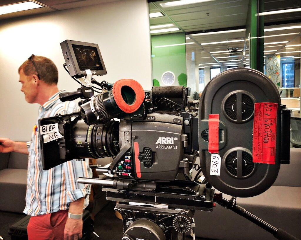 DGA Assistant Director TJ Beagan works near the 35 mm film camera for the Google Startups.