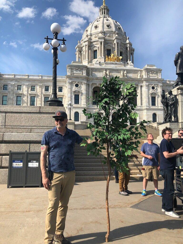 490 Art Director Mark Wojahn stands near set with some greens for the Google Start ups shoot.