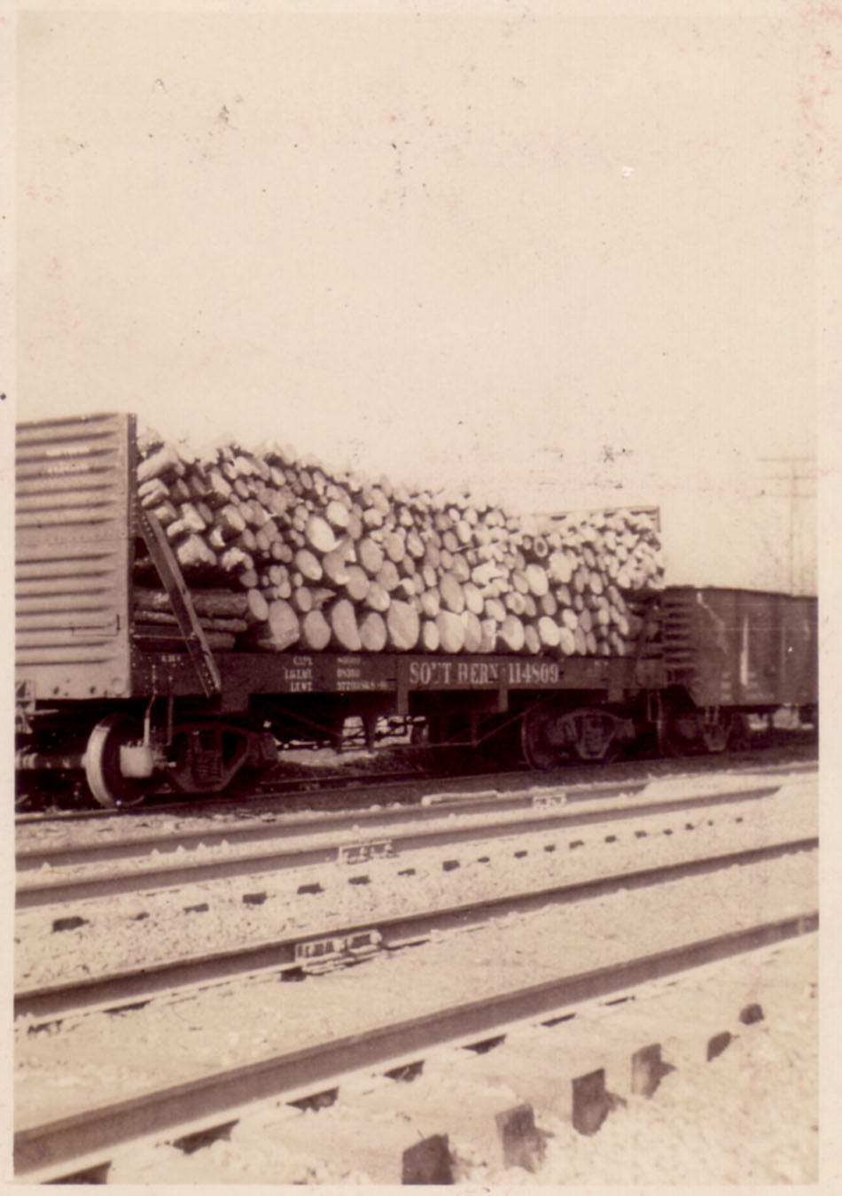 Cord wood loaded and shipped from area just north of depot.  Photo by Hudnalle McLean Sr.