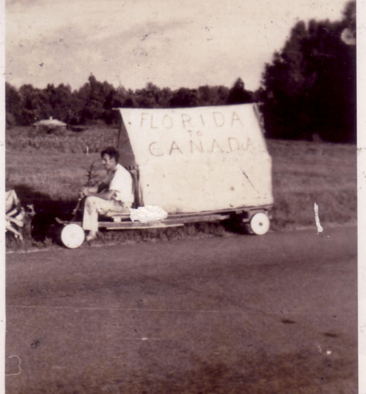 Goat man on trip from Florida to Canada.  Taken by Hudnalle McLean in the late 1940's.