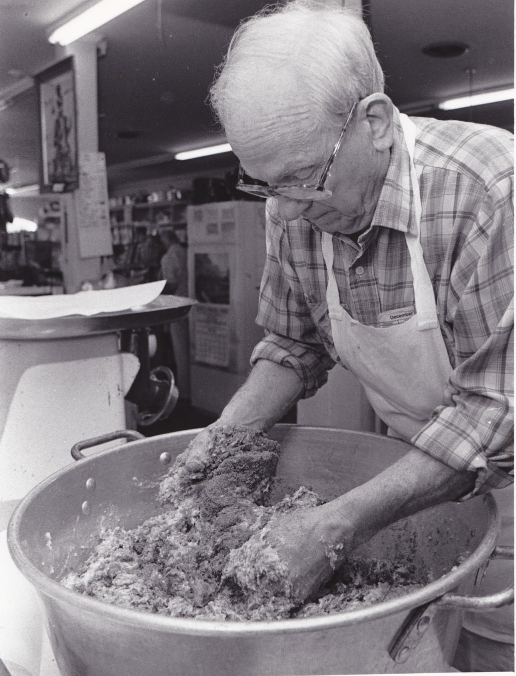 Roger Wilson making his well known pork sausage. Photo taken in early 1980's and provided by his family.