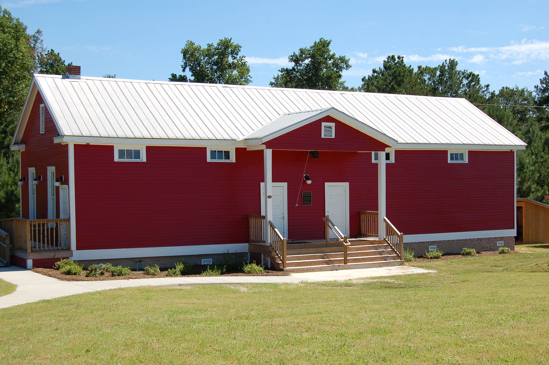 Old Killian School restored and is now located on the grounds of Killian Elementary School. Photo by Jim McLean