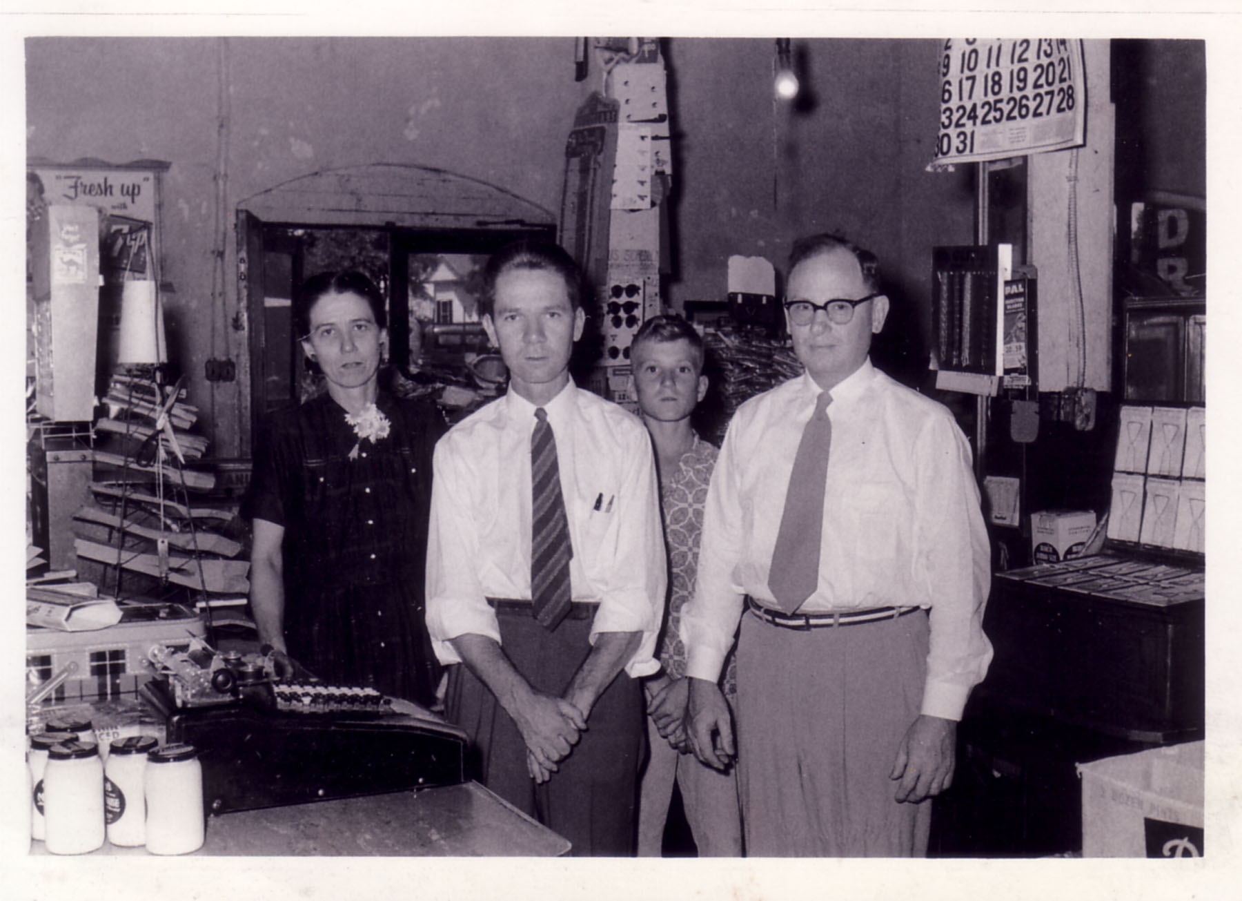 Roger Wilson Buddy Langford, Billie Hawley and Quitman Hawley at checkout counter of Wilson's Store early 1950's.  Photo by Hudnalle McLean Sr.