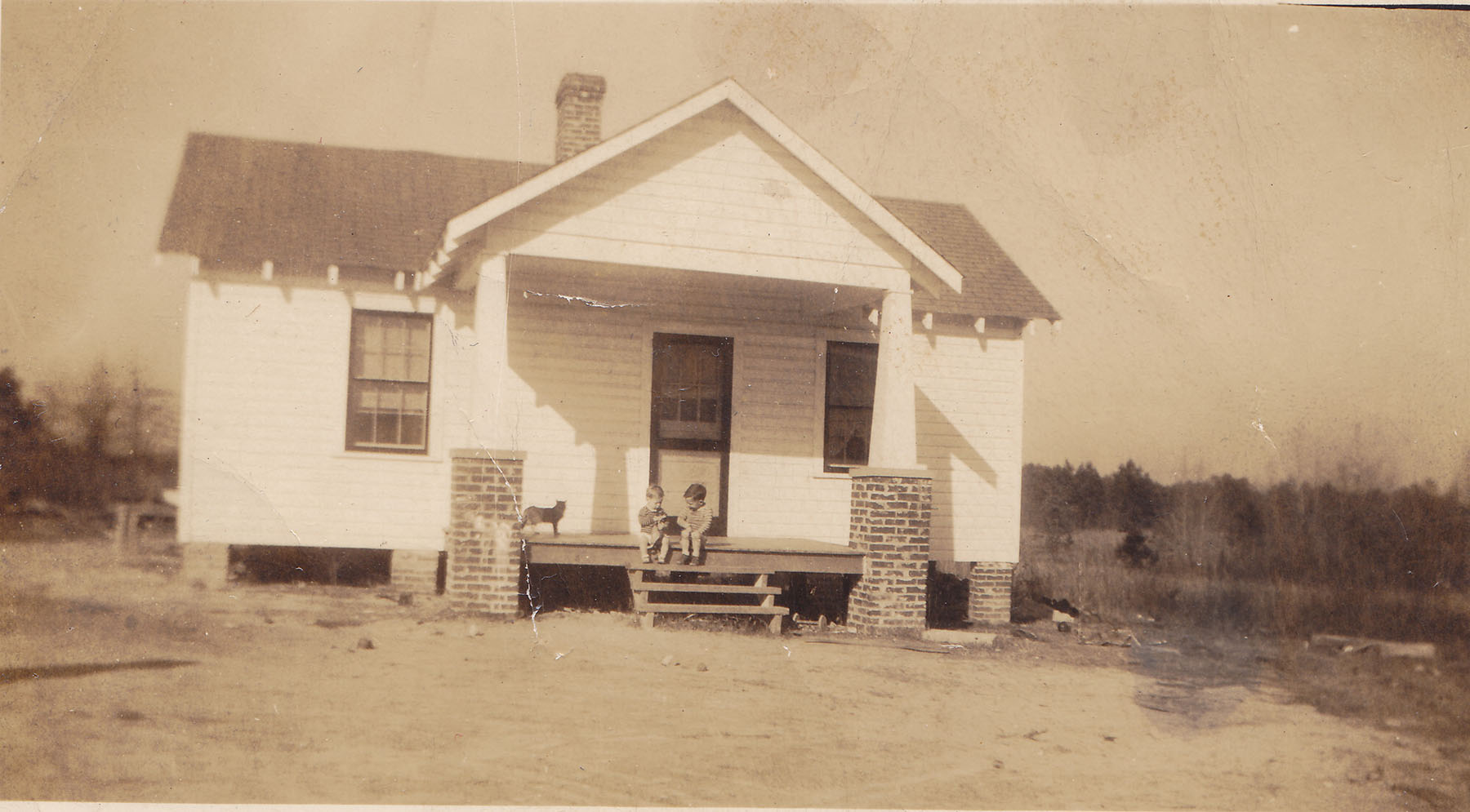 Delmas and Frances McLean home. Kenny and Sammy on porch about 1950.