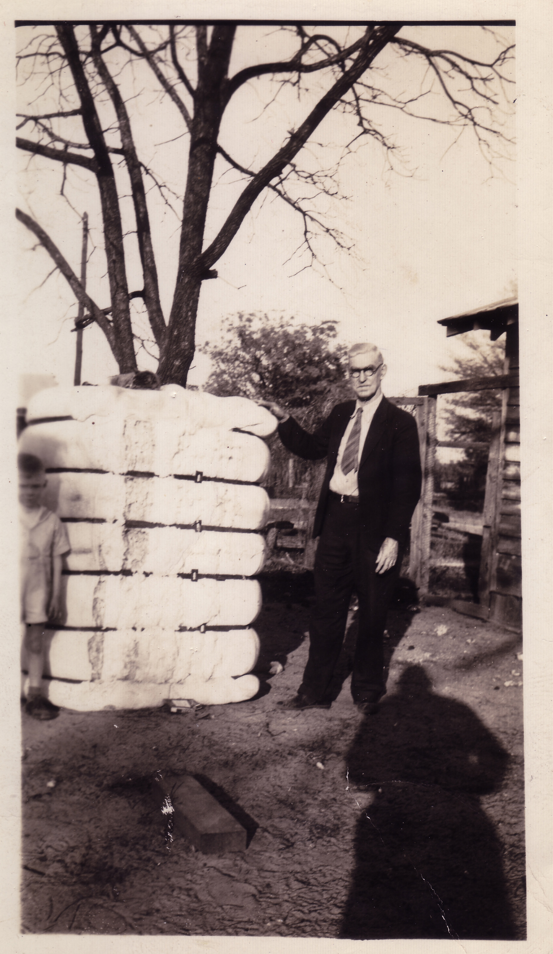 Arch McLean beside bale of cotton. Photo courtesy of Hudnalle McLean Sr.