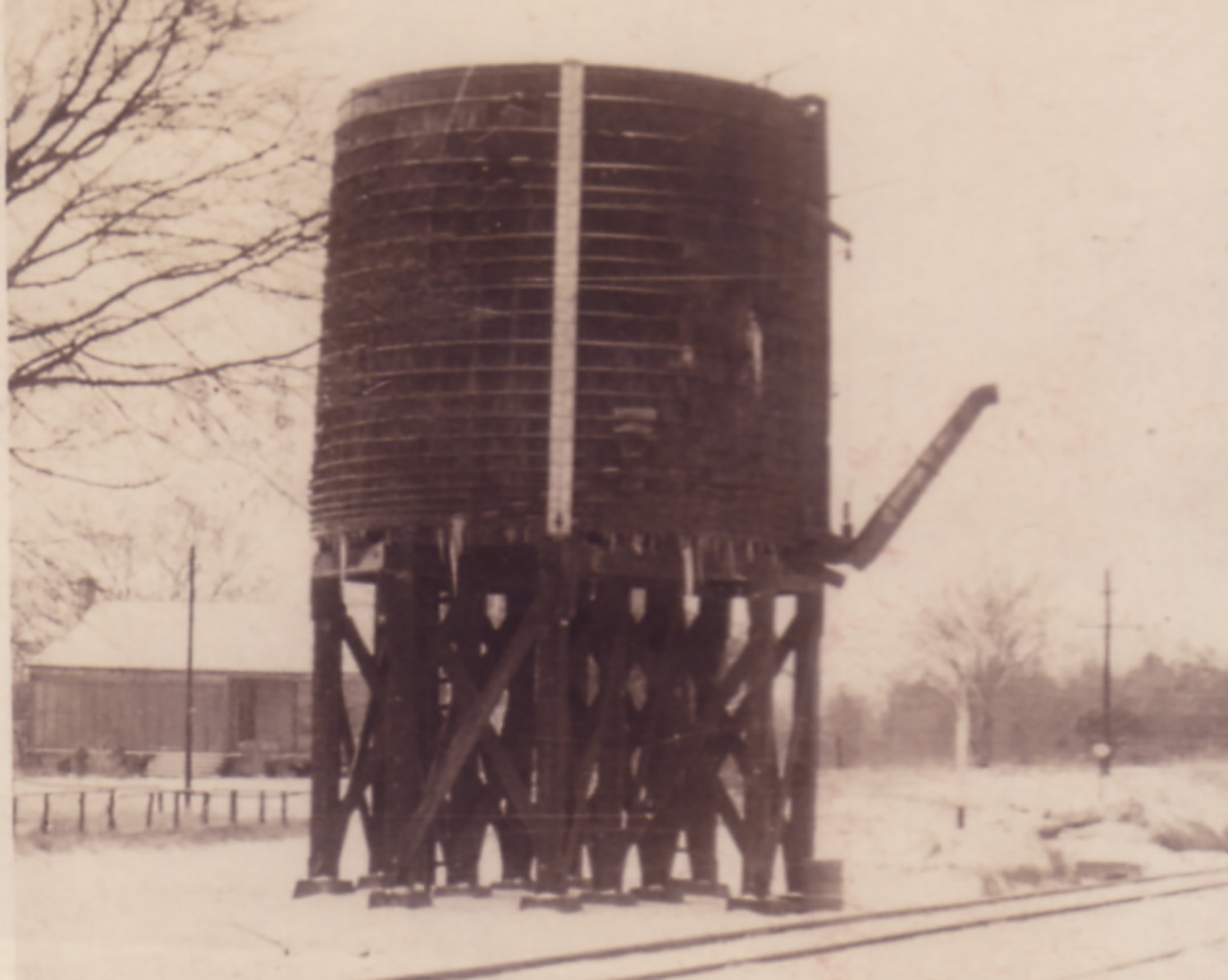 Water Tower and Boney Hykil Home in Background
