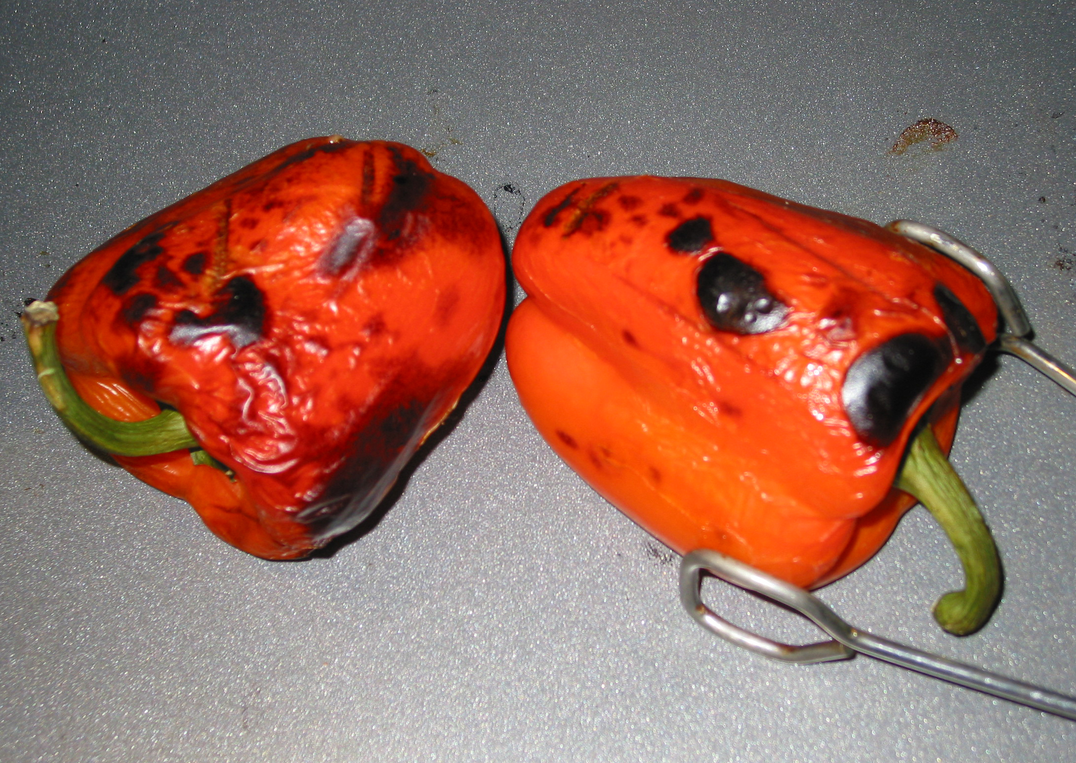 red bell peppers broiling in the oven