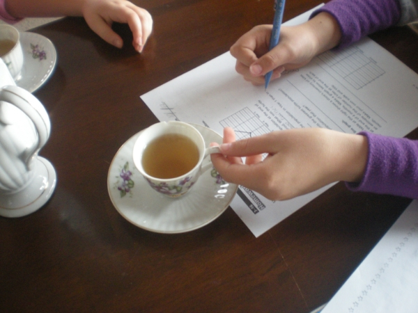 Getting down to work after school with a tasty cuppa tea.