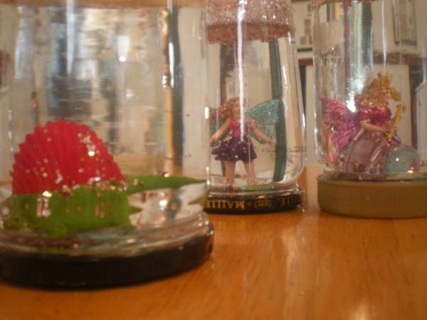 dino and fairy snowglobes