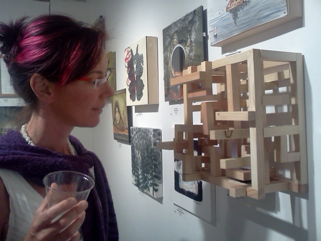 Art goer looking at art by Eliza Furmansky at Around the Square art show at Pioneer Square Art walk in Seattle