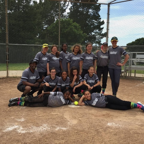 Dr. Abby with her daughter's softball team, which she coaches. Photo: Facebook