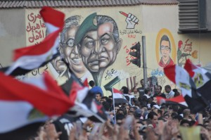 We tried to get close enough to film these murals, but people kept pouring in to Tahrir