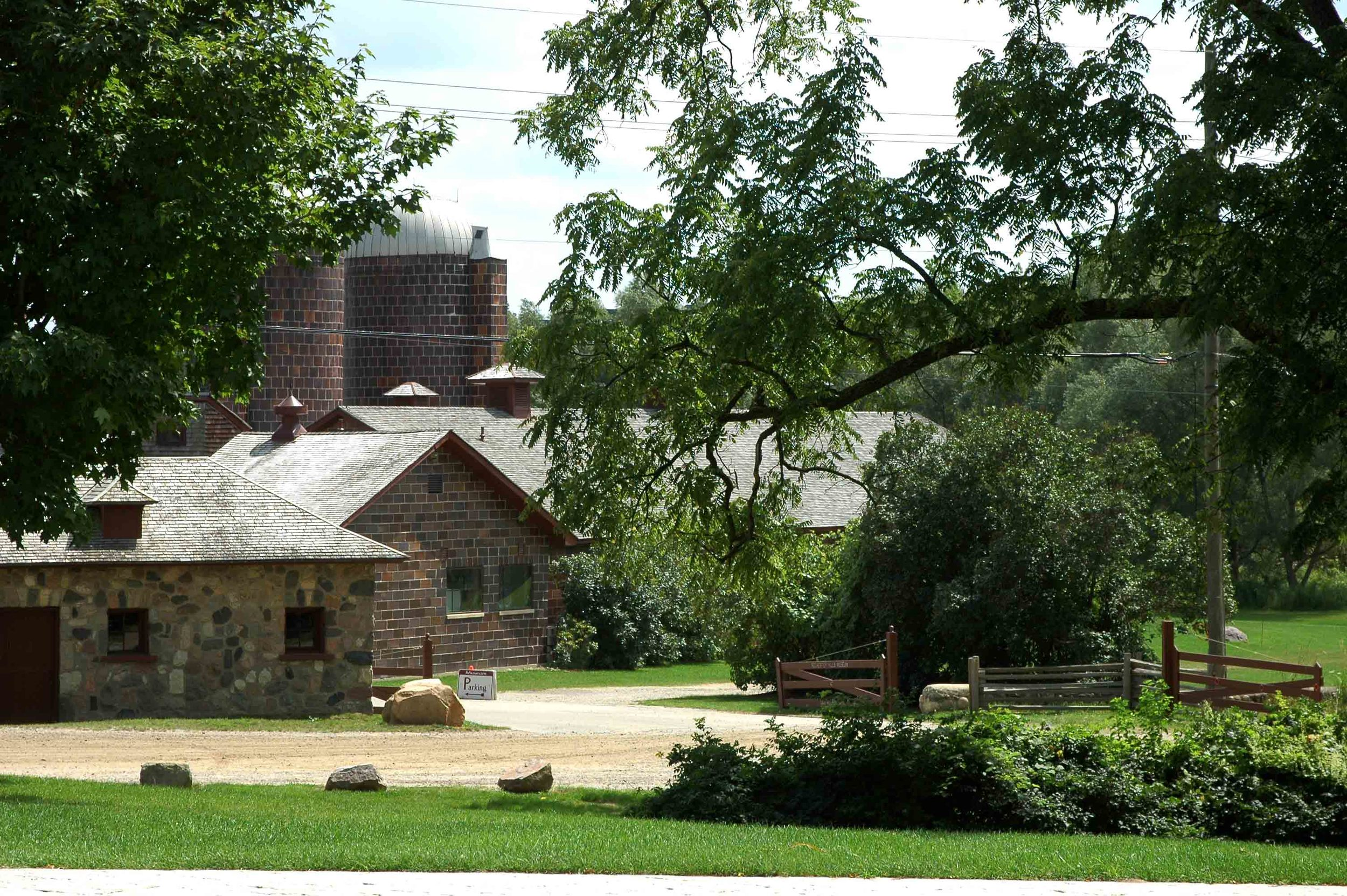 Milk House and Barn from the front yard.